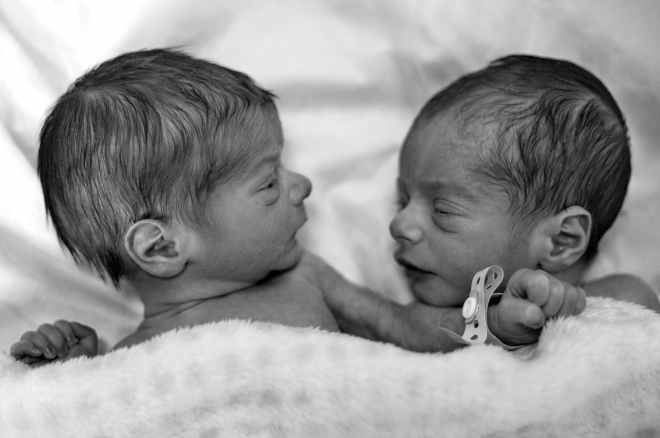 grayscale photography of two newborn